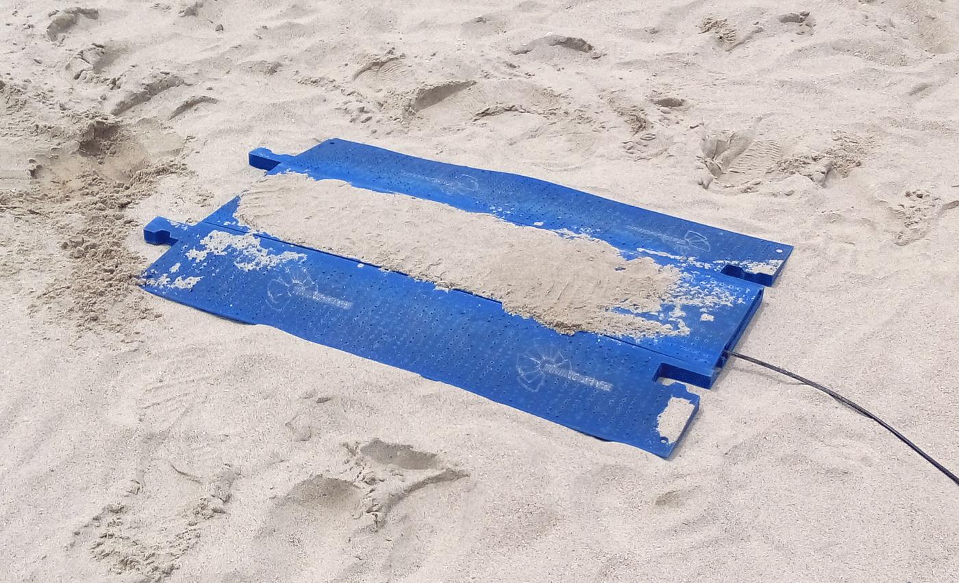 pasacables en arena